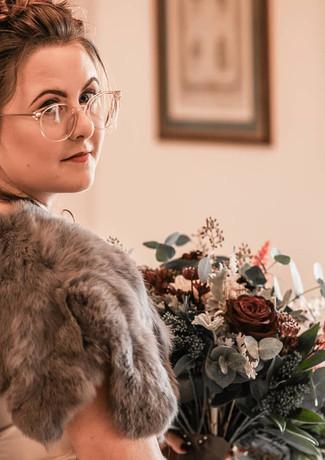 Bride-bridal-bouquet-quicksand-roses-winter-wedding.jpg