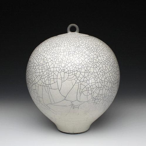 Large raku jar with tin glaze