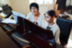 piano lessons at a music school, teacher