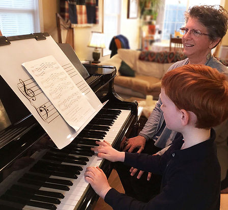 Child and piano teacher | Grand Stand for Piano