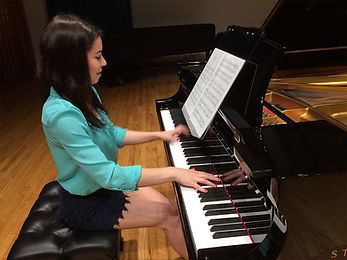 Young lady using Grand Stand | Grand Stand for Piano