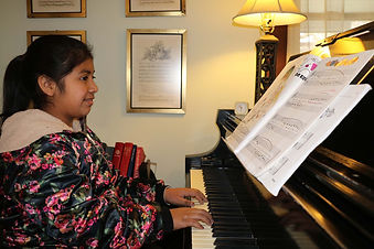 Young girl happy to use Grand Stand | Grand Stand for Piano