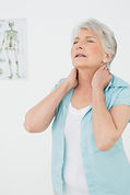 Senior woman suffering from neck pain.jp