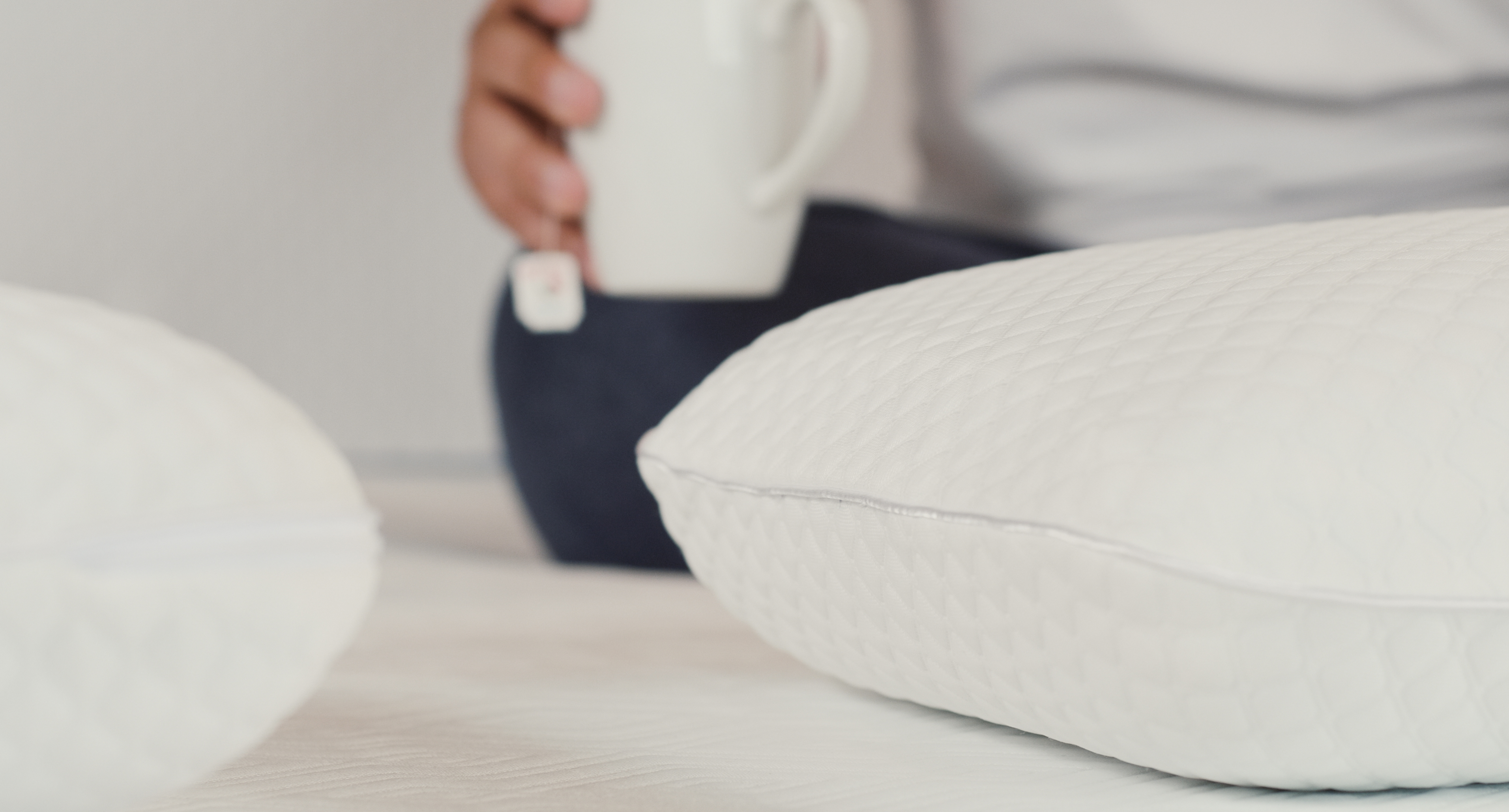 tea and pillows on mattress