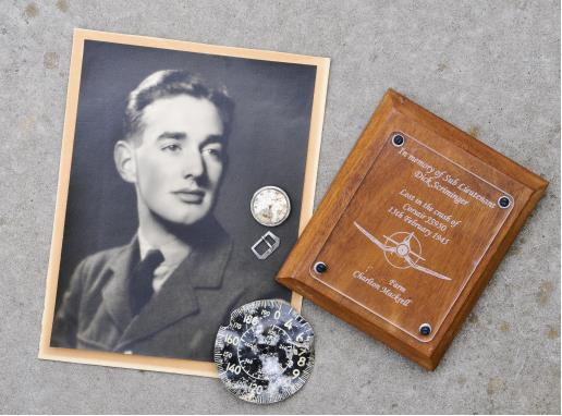 S/L Scriminger, his watch and a plaque presented to his sister.