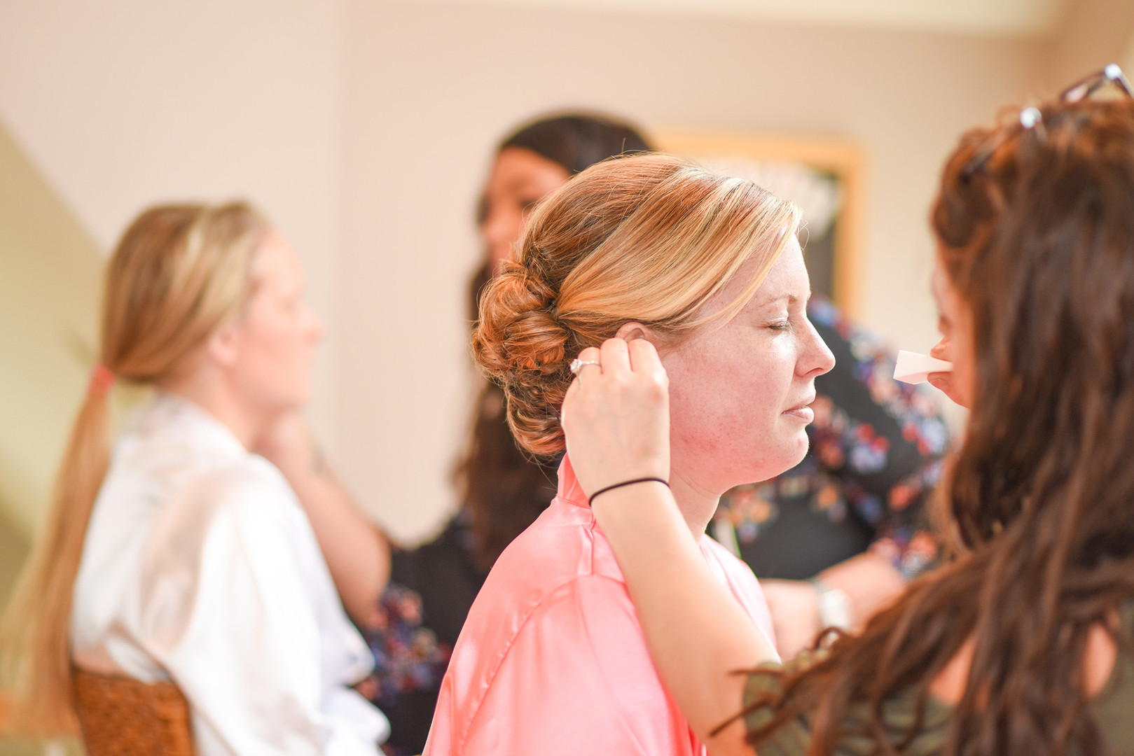 Makeup artist doing bridesmaid's makeup