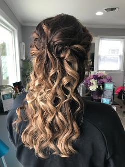 Half-up Half-down curled formal balayage hair