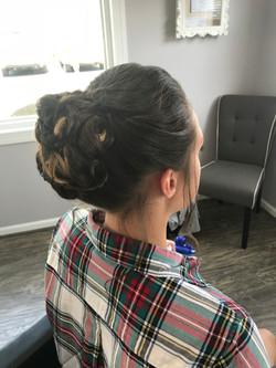Brunette formal updo with braided bun