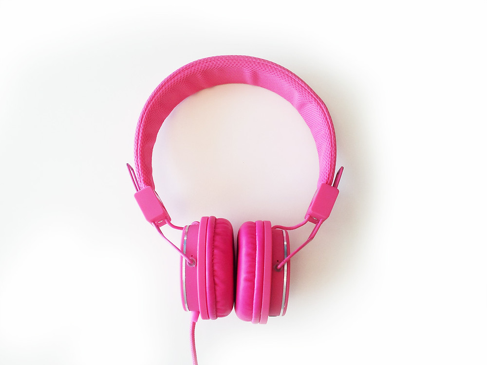 Pink headphones on a white background