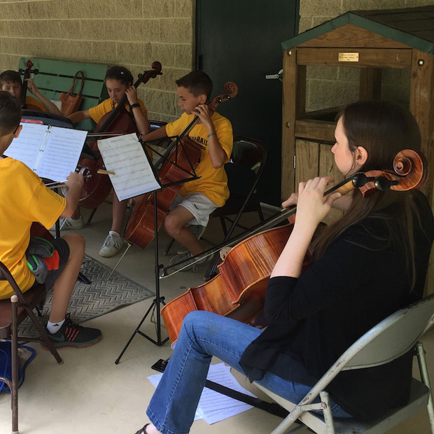 JCSO Coaching Cellists at a Workshop