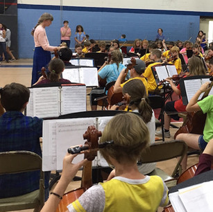 JCSO Working With String Orchestra Students