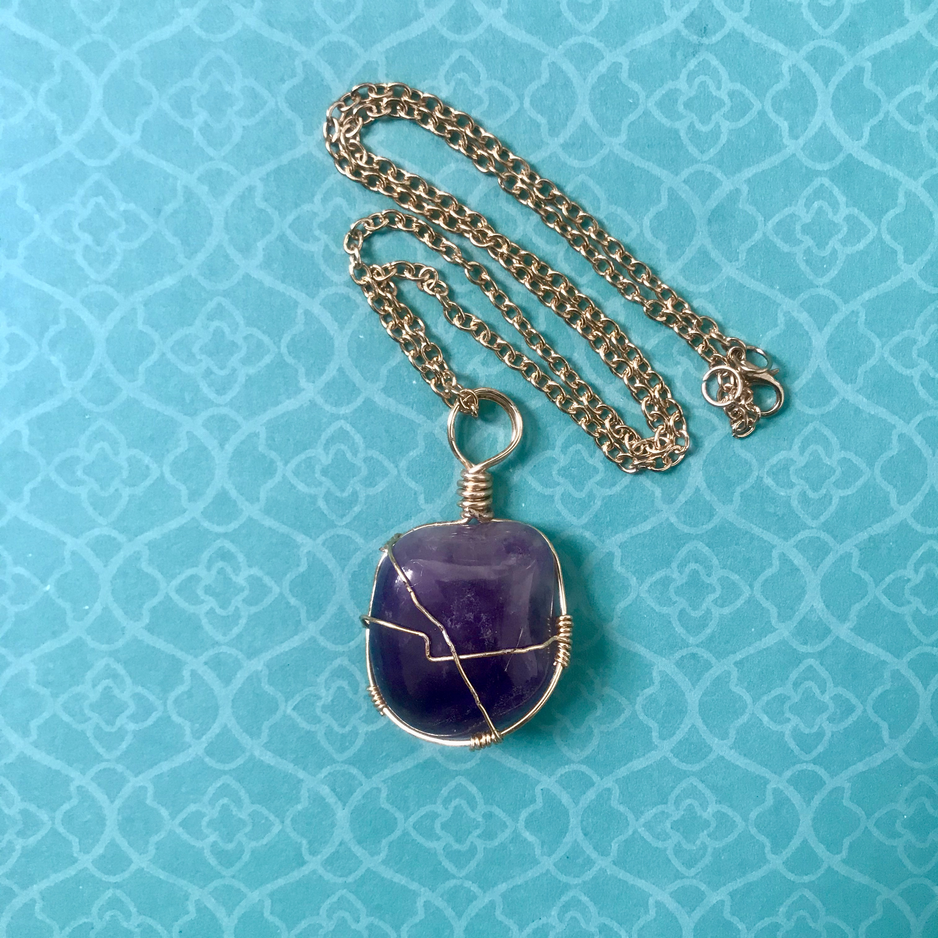 wire wrapped tumbled amethyst pendant
