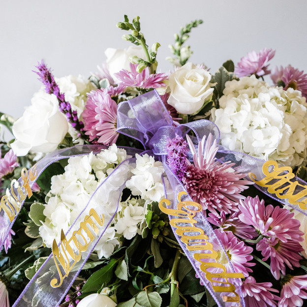 Casket Spray. Mixed white and purple floral