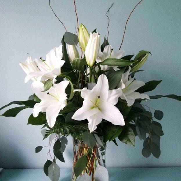 FV-4;Arrangement of white lillies and decorative greens.