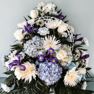 FB-11 Traditional Funeral Basket. Mixed blue and white floral