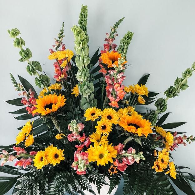FB-10 Funeral table arrangement. Mixed summer floral