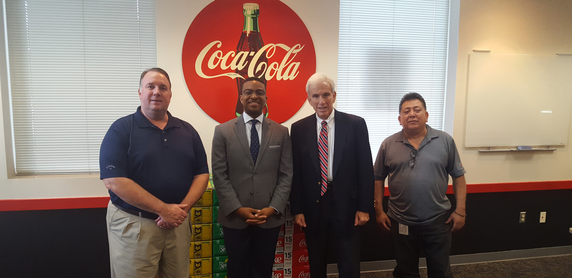 Senator Dick Saslaw (D-Fairfax) visits with associates from Coca-Cola Alexandria