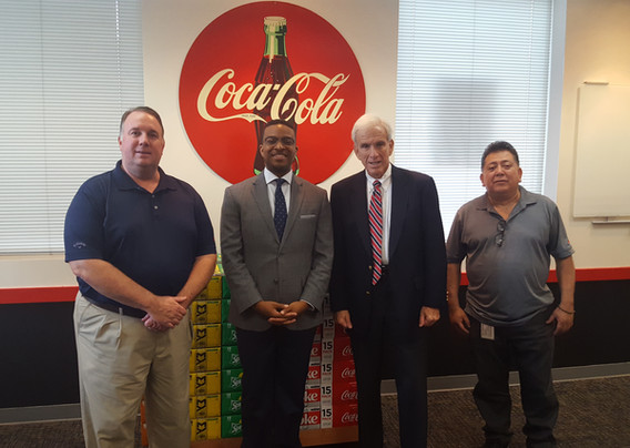 Senator Dick Saslaw (D-Fairfax) visits with associates from Coca-Cola Alexandria