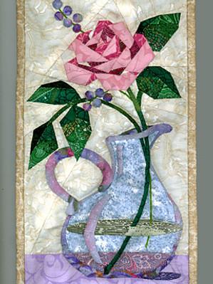 Rose in a Cruet by Linda S. Worland