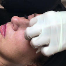 Eyeliner application in progress