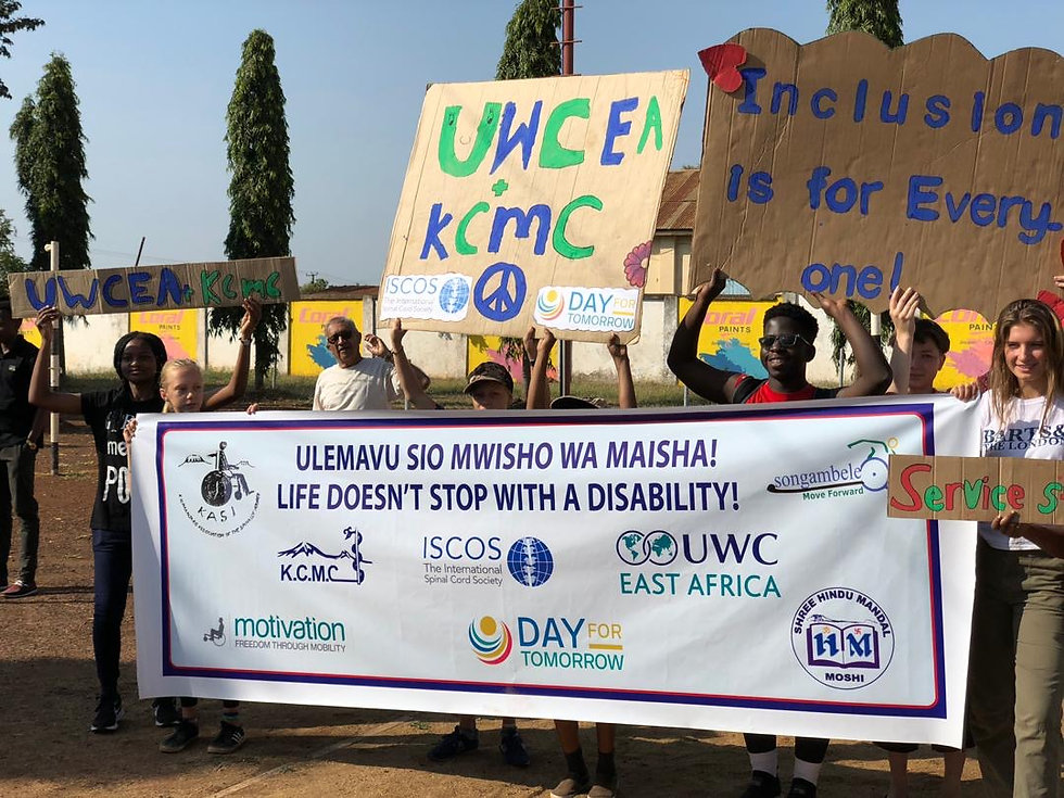 picutre of people in Africa holding a banner that says life doesn't stop with disability