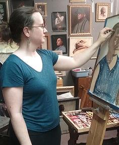 Pastel artist Brigitte Boucher creating a portrait painting from life.