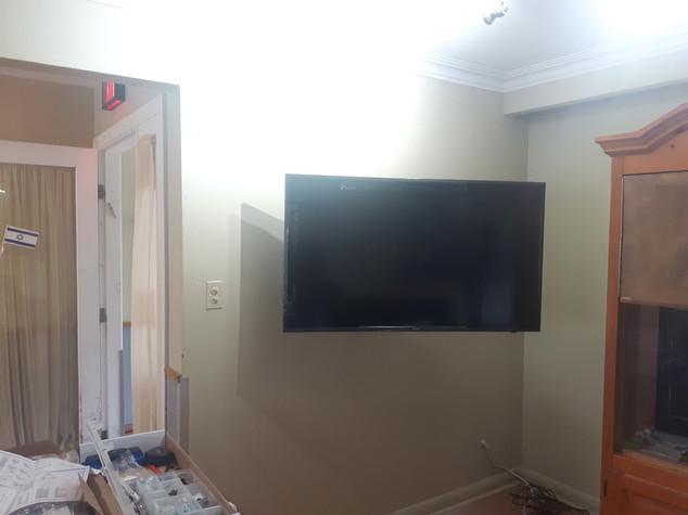 full motion TV wall mount installation