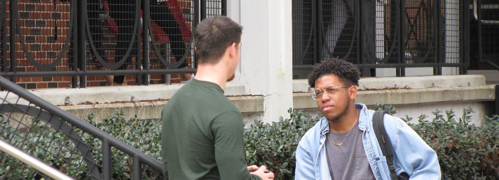 29. Seth conversing with a student at Ni