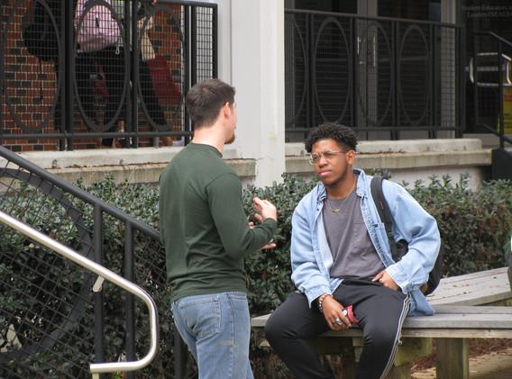 28. Seth conversing with a student at Ni