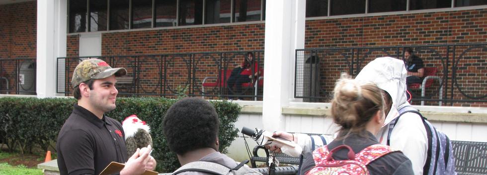 21. Thomas sharing the gospel at NSU, Fe