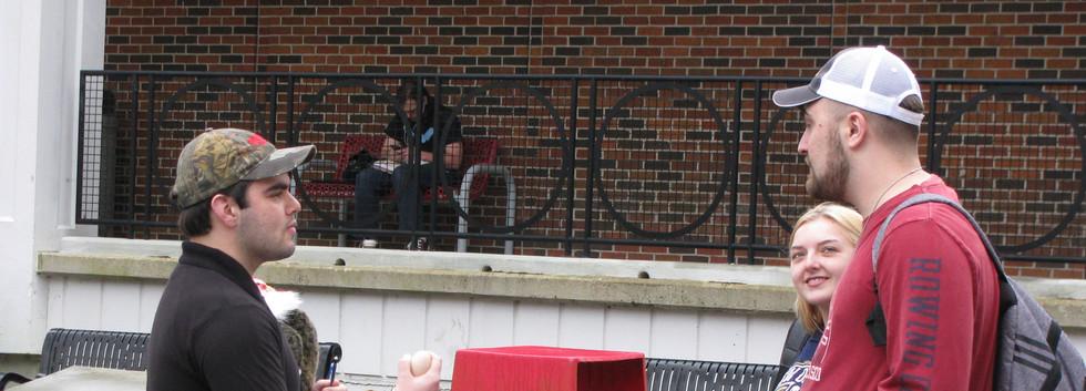 25. Thomas sharing the gospel at NSU, Fe