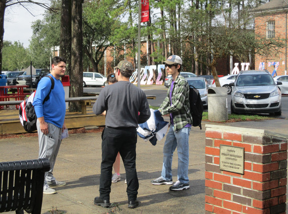 04. Thomas sharing the gospel at NSU - F