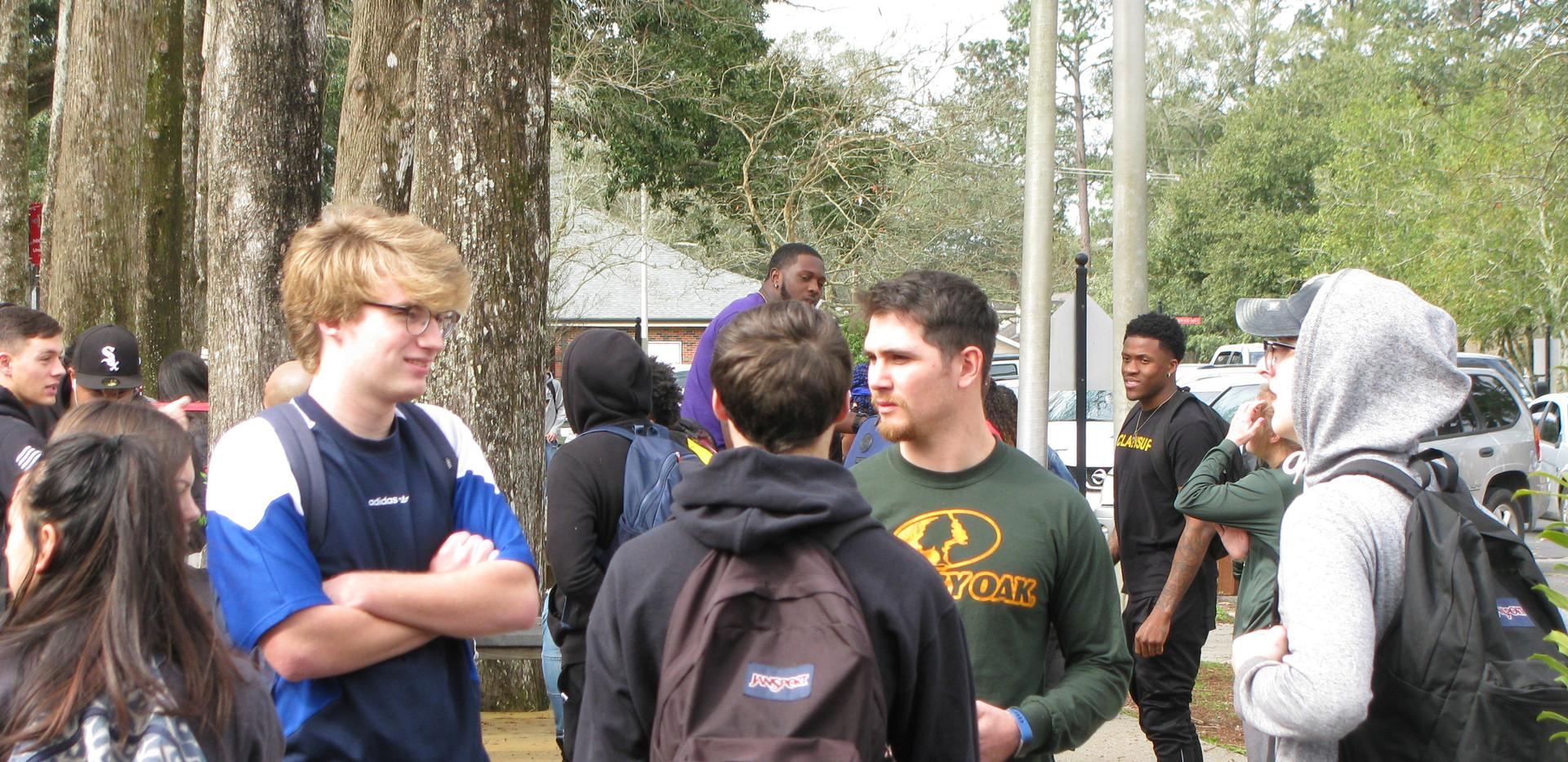 32. Seth sharing the gospel at Nicholls