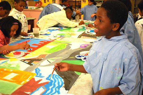 Boy Painting Group Mural.jpg