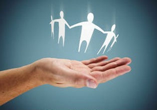 family-in-hand-caring-or-helping-concept