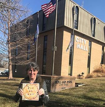 Laura & book at City Hall.jpg