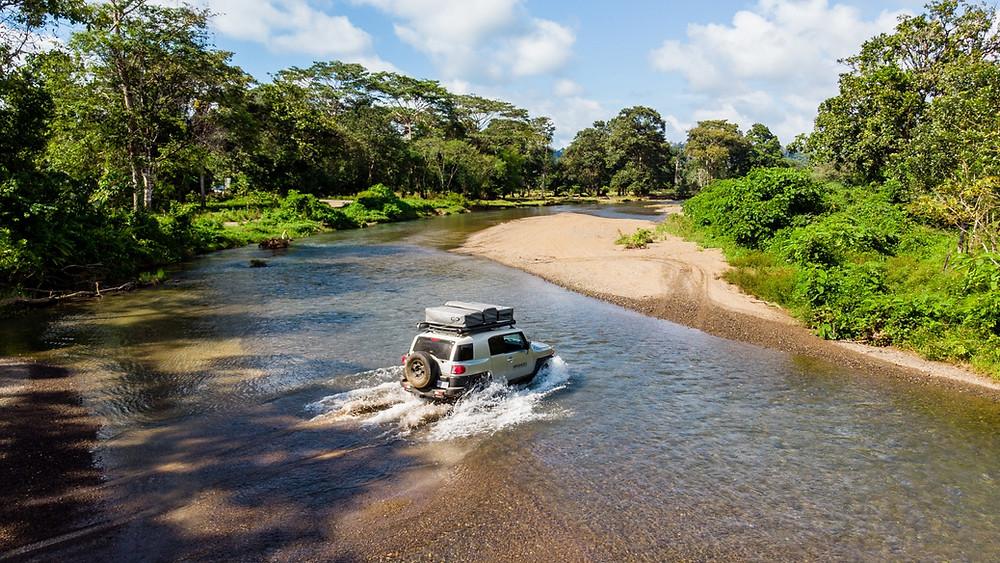 Car crossing a river in Costa Rica