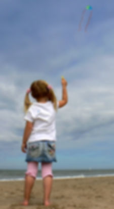 Girl flying a kite: Provide children with the knowledge and awareness that they can resolve their emotional difficulties