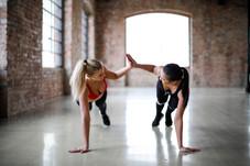 young-slender-female-athletes-giving-hig