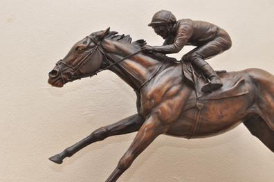 Galloping bronze race horse
