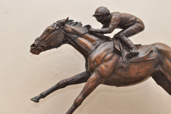 Galloping bronze race horse