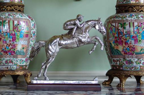 Silver horse sculpture
