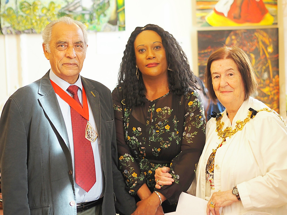The Worshipful Mayor of Croydon, Councillor Bernadette Khan and Consort Mr. Qaiyum Khan, with artist Jean Taylor from the Turks and Caicos Islands.
