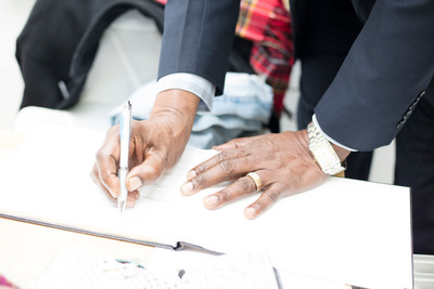 His Excellency Orville London High Commissioner of Trinidad & Tobago, London signs the caribArt Visitors Book