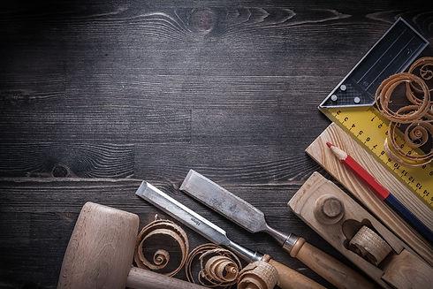 Carpenter tools on wooden board construc
