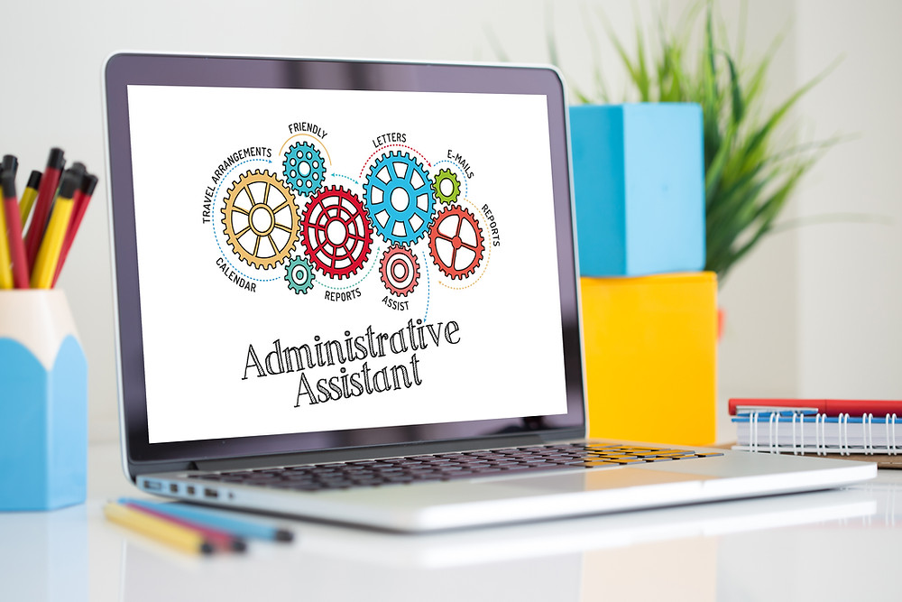 Laptop showing gears and Administrative Assistant