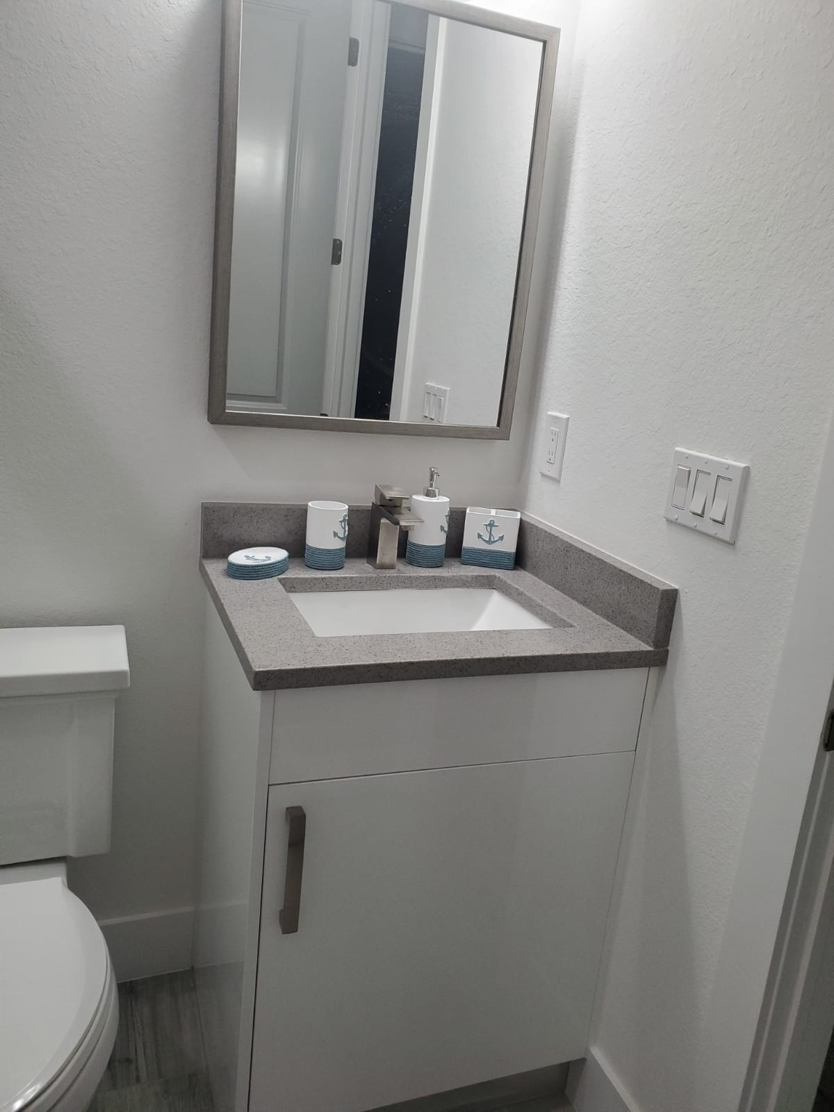 glosswhite vanity and light gray quartz.
