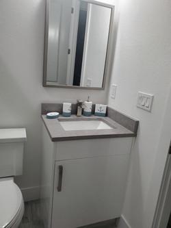glosswhite vanity and light gray quartz.