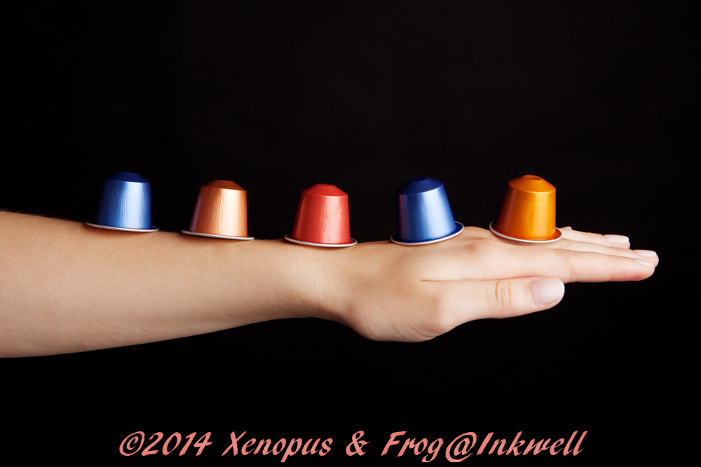coffee capsules balanced on a forearm
