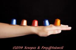 coffee capsules balanced on a forearm
